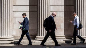 Financial workers walking down street