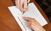 Woman writing a budget © iStock