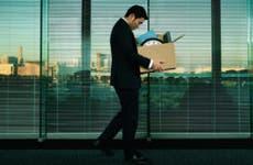 Man holding box full of office stuff