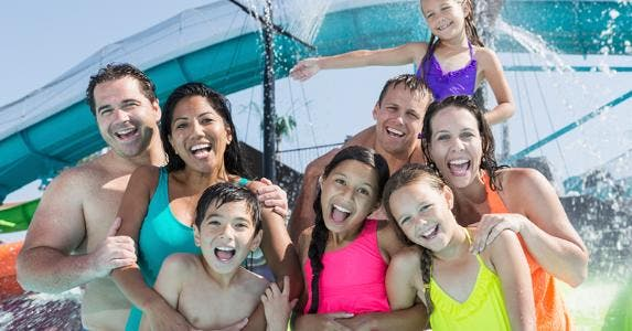 Two families together at water park © iStock