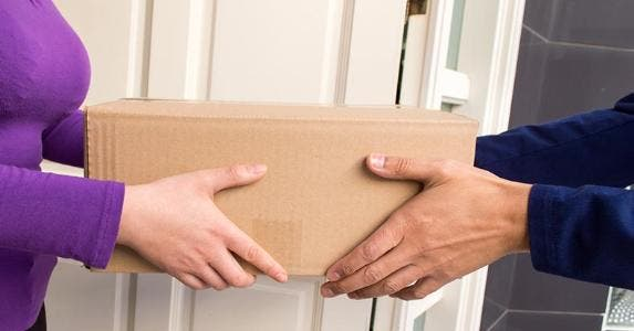 Package being delivered to home | iStock.com/Manuel Faba Ortega