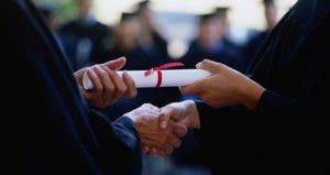 Graduate shaking hands and getting diploma | Chad Baker/Jason Reed/Ryan McVay/Photodisc/Getty Images