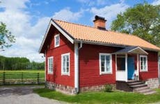 Small red house on a farm | LordRunar/Getty Images
