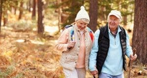 Senior couple hiking in the woods | Monkey Business Images/Shutterstock.com
