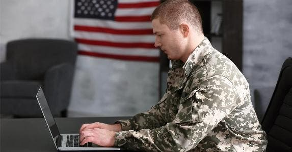 Military man using laptop | Africa Studio/Shutterstock.com