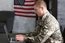 Military man using laptop | Africa Studio/Shutterstock.com