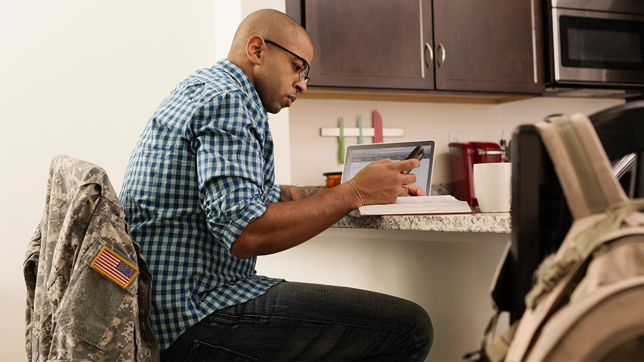 Man studying in kitchen