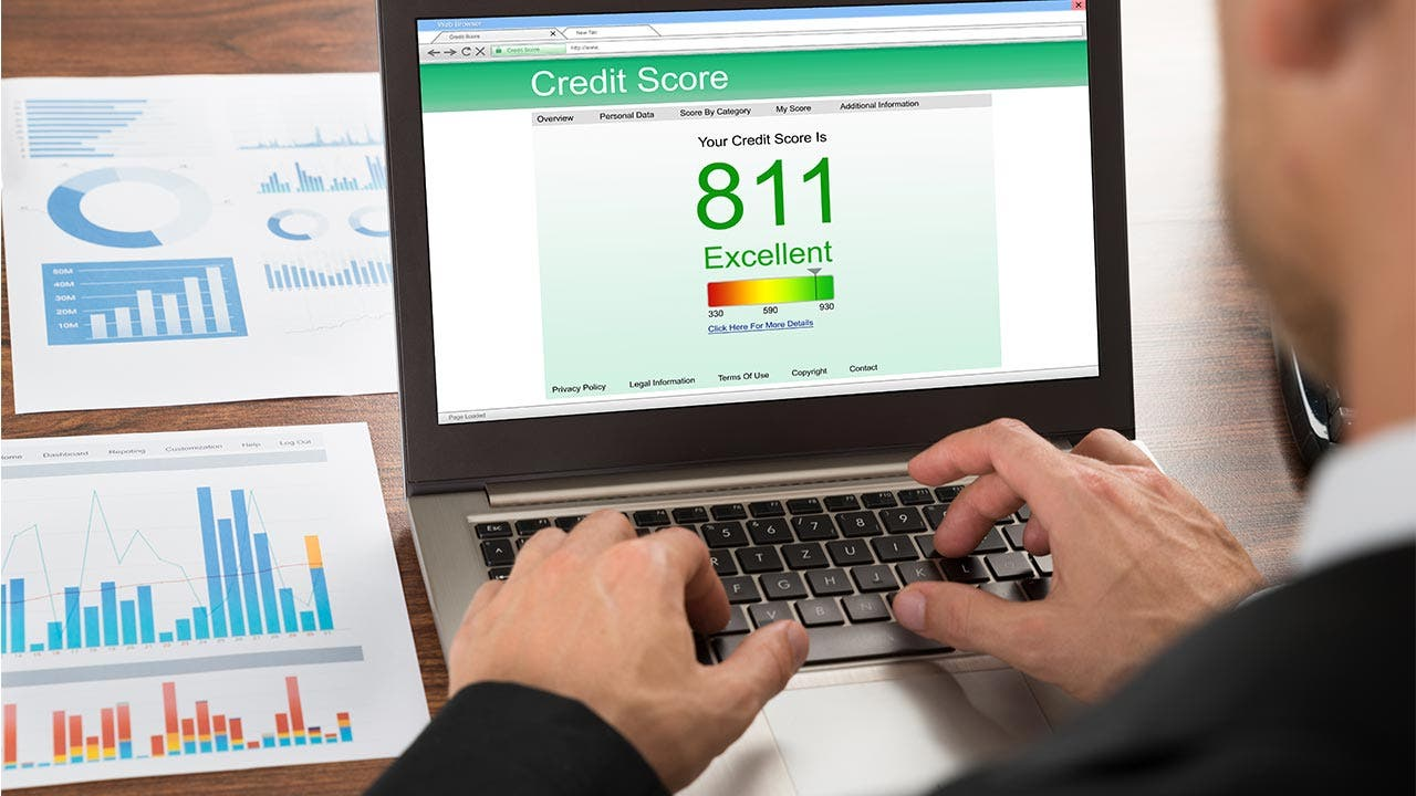 Man checking his credit score online