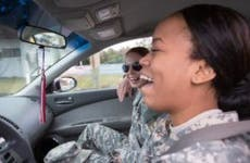 Laughing military women in car | Sean Murphy/Getty Images