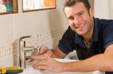 Young man fixing faucet © iStockPhoto.com