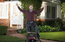 Chris Pratt holding up hands in front yard, surprised