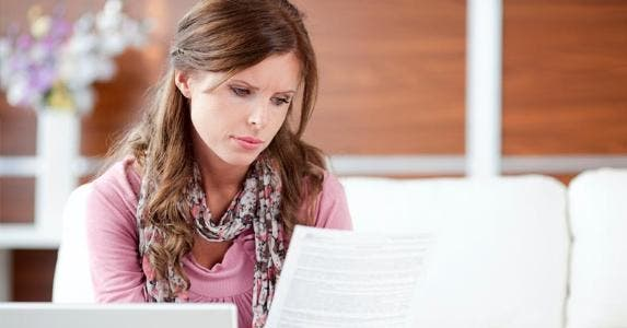 Woman looking at a letter © iStock