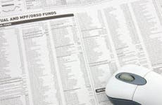 Wireless mouse over mutual funds data on newspaper © Norman Chan/Shutterstock.com
