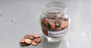 A jar of pennies for a rainy day fund © Beth Swanson/Shutterstock.com