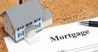 Toy house a mortgage form © Matthew Benoit /Shutterstock.com