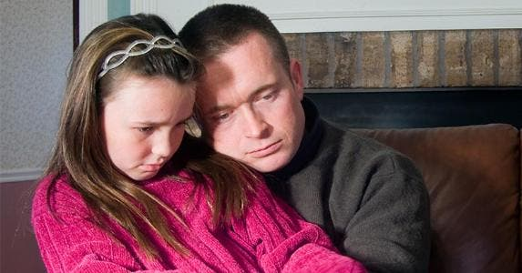 Sad dad and young daughter | Rhienna Cutler/Getty Images