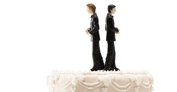 Two grooms on wedding cake, facing away from each other © iStock