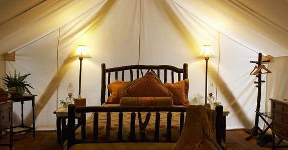 Tent interior with bed and lamps © iStock
