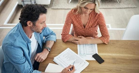 Husband and wife working together on budget © iStock