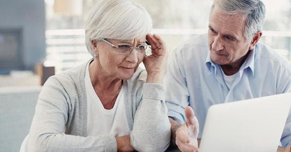 Senior couple stressed, concerned over bills © iStock