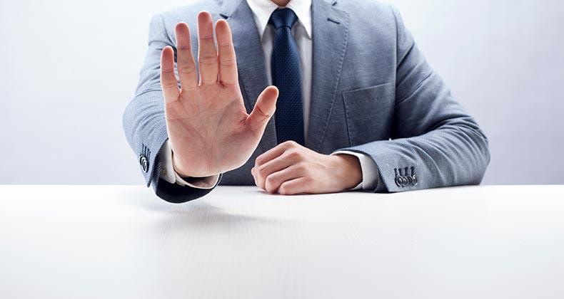 Businessman gesturing stop © iStock