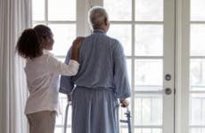 Nurse resting hand on senior's shoulders | Terry Vine/Blend Images/Getty Images