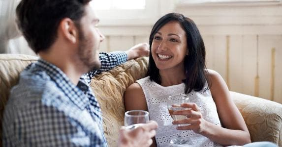 Couple having wine on the couch   Morsa Images/DigitalVision/Getty Images