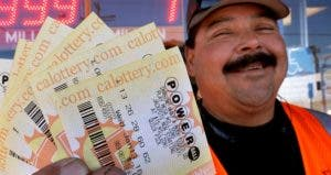 Man holding Powerball tickets | Justin Sullivan/Getty Images