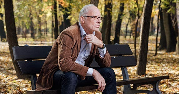 Older man sitting on bench