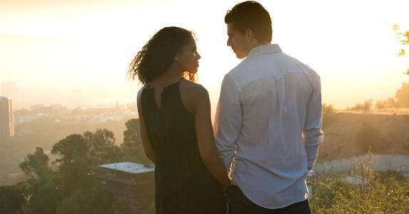 Young couple checking out view from top | Christopher Malcolm/DigitalVision/Getty Images