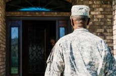 Military veteran walking towards front door | Inti St Clair/Blend Images/Getty Images