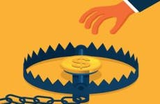 Illustrated hand grabbing coin from trap | Getty Images