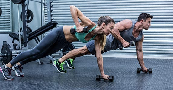Woman working out with dumbell