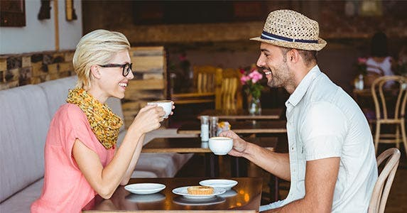 Man and woman enjoying coffee at a table