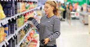 Woman in pasta aisle of grocery store | LADO/Getty Images