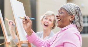 Women having fun in painting class | kali9/Getty Images