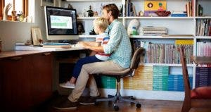 Father working from home with son on his lap   Morsa Images/Getty Images