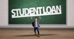 Male college student holding a sign of student loan © Creativa/Shutterstock.com