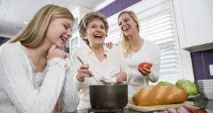 Adult children cooking dinner with their mother © Golden Pixels LLC/Shutterstock.com