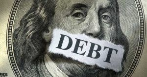 Benjamin Franklin's mouth covered with the word 'debt' | iStock.com/DNY59