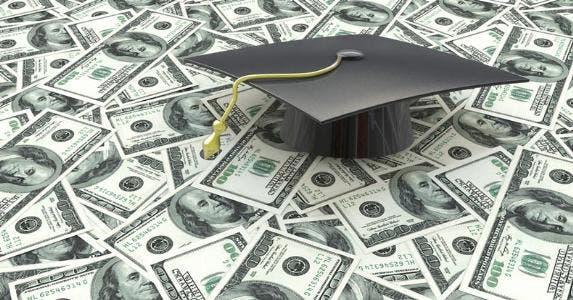Graduation cap on $100 bills © iStock