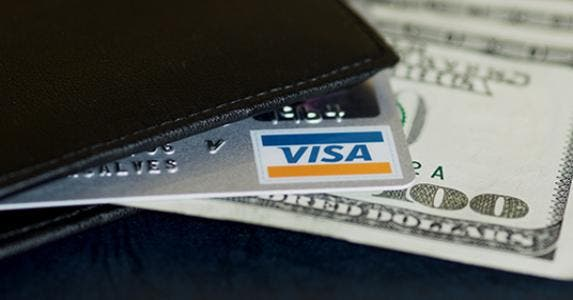 Visa card in wallet © Maria Goncalves - Fotolia.com
