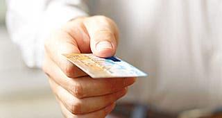 Man holding credit card © ievgen sosnytsky/Shutterstock.com