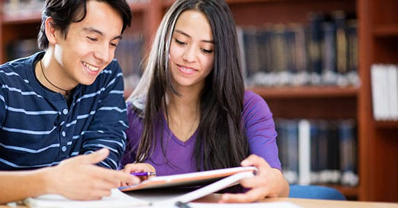 Savings can fund grad school © Andresr/Shutterstock.com