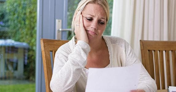 Woman looking sadly at paper © Twin Design/Shutterstock.com