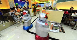 Robot-themed restaurant opens in east China © Imaginechina/Corbis