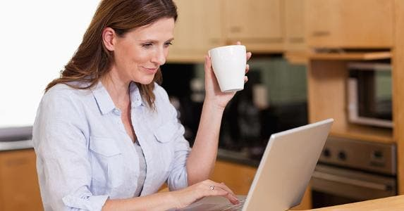 Woman using her laptop in kitchen © wavebreakmedia/Shutterstock.com