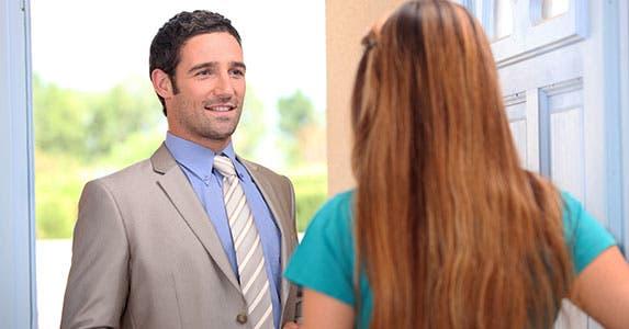 Bothersome door-to-door sales tactics © auremar/Shutterstock.com