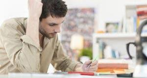 Man looking at paperwork © Jack Frog/Shutterstock.com
