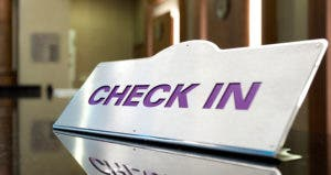 'Check in' sign © iStock